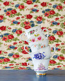 Stack of vintage tea cups. Antique and colorful tea cups stacked for high tea Royalty Free Stock Photos