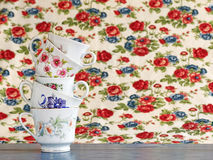 Stack of vintage tea cups. Antique and colorful tea cups stacked for high tea Stock Photos