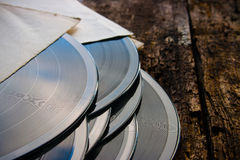 Stack of vinyl records on a wooden background Royalty Free Stock Photography
