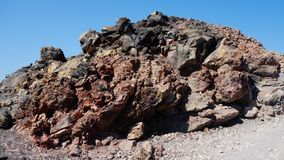 Vulcanic stones in Santorini, Greece. A stack of vulcanic stones on the crater of the island in Santorini, Greece stock image