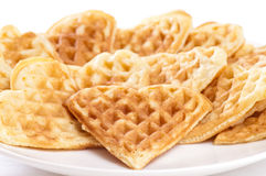 Stack of waffles in shape of heart. On plate Royalty Free Stock Image