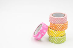 Stack of Warm Colored Colorful Washi Tape on White Background. Horizontal Stock Photo