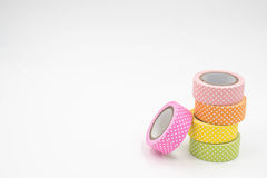 Stack of Warm Colored Colorful Washi Tape on White Background. Horizontal Stock Images