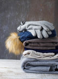 Stack of warm knitted clothes Royalty Free Stock Photos
