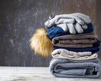 Stack of warm knitted clothes Royalty Free Stock Photo