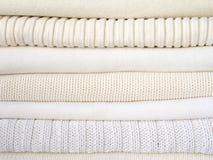 Stack of warm white clothes Stock Photos