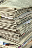 Stack of waste paper. old newspapers. A stack of old newspapers awaiting removal by waste paper disposal Stock Image