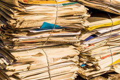 Stack of waste paper. old newspapers. A stack of old newspapers awaiting removal by waste paper disposal Royalty Free Stock Photo