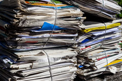 Stack of waste paper. old newspapers. A stack of old newspapers ready for removal by disposal of waste paper Stock Photos