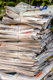 Stack of waste paper. old newspapers. A stack of old newspapers ready for removal by disposal of waste paper Royalty Free Stock Photo