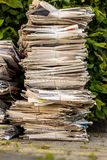 Stack of waste paper. old newspapers. A stack of old newspapers ready for removal by disposal of waste paper Stock Photo