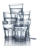 Stack of water glasses. With water Stock Image