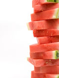 Stack watermelon portrait. A stack of watermelon slices isolated on white Stock Photos