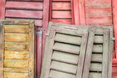 Stack of weathered louver doors. On an antiques market Royalty Free Stock Image
