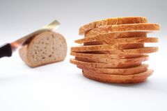 Stack of Wheat Sliced Bread on Top of White Surface Royalty Free Stock Images
