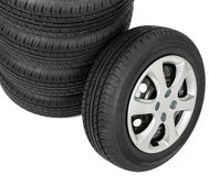 Stack of wheels on white background. Close-up Stock Images