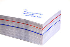 Stack of white addressed envelopes. Stack of white envelopes with an address and, between them, one red and one blue Royalty Free Stock Images