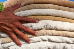 Stack of white  and broun plush hotel towels Royalty Free Stock Photography