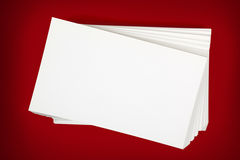 Stack of Business Cards over Red Background Royalty Free Stock Photography