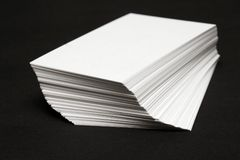 Stack of White cards. Against a black background Stock Image