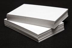 Stack of White cards. Against a black background Stock Photo