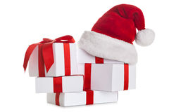 Stack of white Christmas gift with Santa Claus hat. Stack of white Christmas gift, with Santa Claus hat on white background Royalty Free Stock Photography
