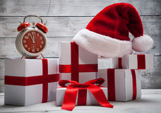 Stack of white Christmas presents, with Santa Claus hat Royalty Free Stock Photography