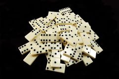 Stack of white dominoes on black background Royalty Free Stock Photography