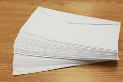 Stack of white envelopes on a table Royalty Free Stock Photo