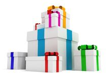 Stack of white gift boxes decorated with bows Royalty Free Stock Images