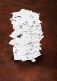 Stack of White Jigsaw Pieces stock image