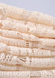 Stack of white openwork knitted fabric Stock Photos