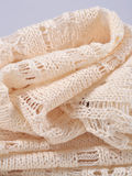 Stack of white openwork knitted fabric Royalty Free Stock Images