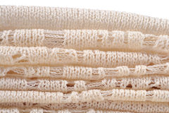 Stack of white openwork knitted fabric Stock Image
