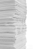 Stack of white paper. With full isolated white background Royalty Free Stock Photo