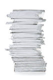 Stack of white paper. On a white background Stock Photography