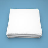 Stack of white paper on blue background Stock Photography