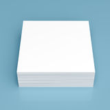 Stack of white paper on blue background Royalty Free Stock Image