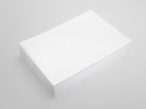 Stack of white paper on gray background Royalty Free Stock Photo
