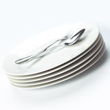 Stack of white plates Royalty Free Stock Photos