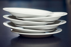 A stack of white plates Stock Photo