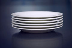 Stack of white plates Royalty Free Stock Photography