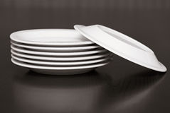 Stack of white plates Stock Image