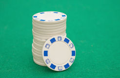 Stack of white poker chips on casino table Royalty Free Stock Images