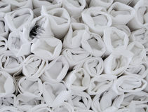 Stack of white restaurant napkins with utensils rolled into them Royalty Free Stock Images