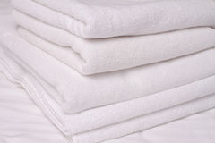 Stack of white and soft towels. Using Laundry Detergents  conditioners. Royalty Free Stock Images