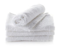 Stack of white spa towels. On white background royalty free stock photo