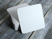 Stack of white square beer coasters Royalty Free Stock Photos