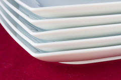 Stack of white square plates Stock Photos