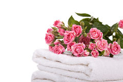 Towels and a bouquet of roses Royalty Free Stock Image